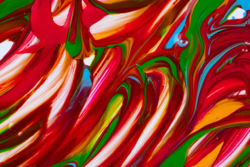 From above concept of multicolored brush strokes of acrylic colors on white canvas