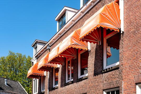 Orange basket awnings over the windows