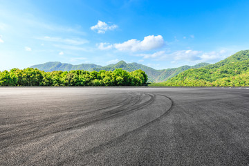 Acrylic Prints F1 Asphalt race track ground and green mountains natural landscape
