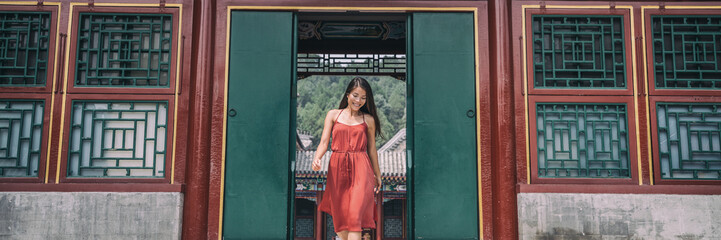 Wall Mural - Beautiful Asian woman tourist at chinese temple