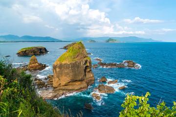 Papuma Beach, Blue Lagoon with Green Rockes, East Java, Indonesia