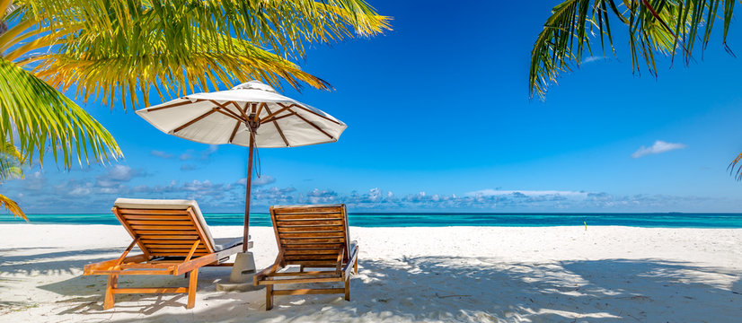 Luxury travel concept. Beautiful beach. Chairs on the sandy beach near the sea. Summer holiday and vacation panorama for tourism. Inspirational tropical landscape