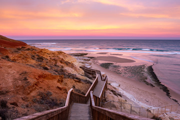 A beautiful sunrise at southport port noarlunga south australia overlooking the wooden staircase ocean and cliffs on the 30th April 2019 Wall mural