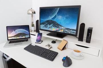 Fototapeta Computer and devices on modern white desk interior 3D rendering