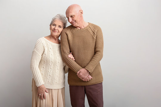 Portrait of senior couple on white background