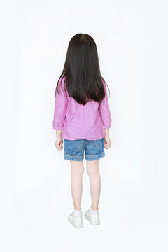 Rear view little Asian child girl standing with long hair isolated over white background.