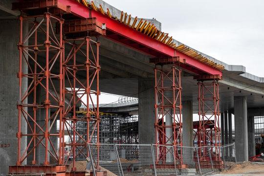 Construction site, construction, scaffolding, scaffolding. The concept of construction work, design, architecture.