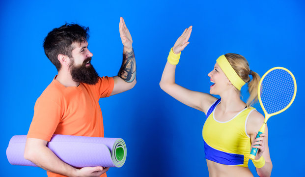 Healthy lifestyle concept. Man and woman couple in love with yoga mat and sport equipment. Fitness exercises. Workout and fitness. Girl and guy live healthy life. Fitness exercises. Sporty couple