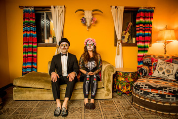Man and woman in Dia de los Muertos makeup and costume, Day of the Dead celebration in the desert, California, United States of America, North America