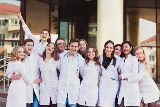 Education and health. general practitioner. A group of smart medical students in college. Friends interns on the background of the hospital.