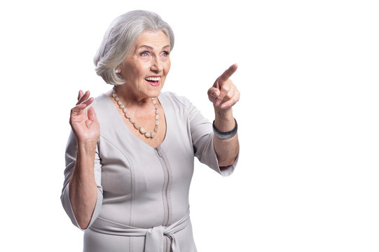 Portrait of beautiful senior woman pointing to the right