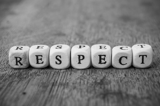 Closeup of word on wooden cube on wooden desk background concept - Respect