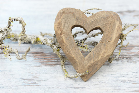 heart and branch lying on wood