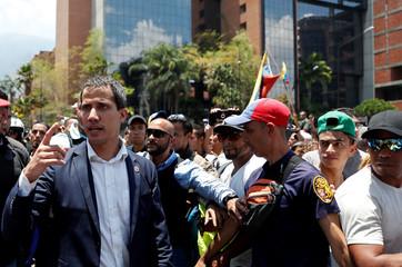 Venezuelan opposition leader Juan Guaido walks with supporters in Caracas