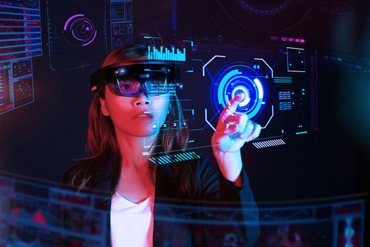 Business woman try vr glasses hololens in the dark room | Portrait of young asian girl experience ar communication | Future technology concept