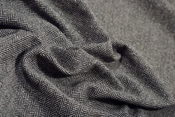 Draped herringbone tweed wool fabric texture