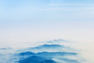 Aerial landscape mountains lost in thick fog in China, bird eye view landscape look like a chinese style of painting