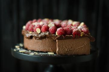Chocolate Cheesecake with Chocolate Sauce and Raspberries