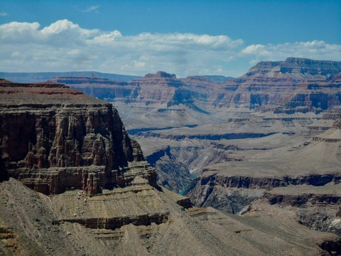 A view from inside the Grand Canyon showing layers of rock and Colorado river