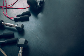 Dumbbells, and skipping rope . Top view. Fitness, sport and healthy lifestyle concept.
