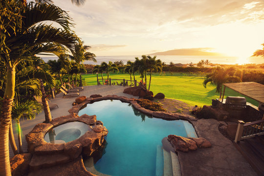 Luxury Home With Swimming Pool At Sunset