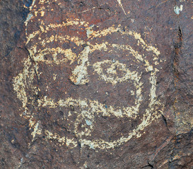 Petroglyph National Monument protects 1 of the largest petroglyph sites in North America designs and symbols carved on volcanic rocks by Native Americans & Spanish settlers  Albuquerque, New Mexico