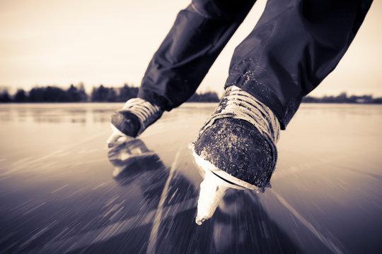 Ice Skating With Hockey Skates On A Frozen Surface; Alaska, United States Of America