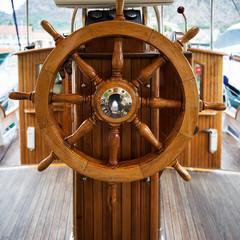 Wooden steering wheel on a boat; Kotor, Montenegro