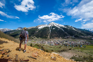 A senior man hiking with a view of Kendall Mountain in the distance; Silverton, Colorado, United States of America