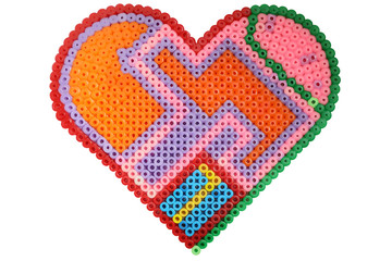 Applique in the shape of a heart made of shiny plastic multicolored beads isolated on white background