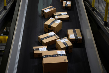 Boxes ready to be loaded onto a delivery truck move along a conveyor belt at the Amazon fulfilment centre in Baltimore