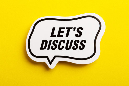 Let Us Discuss Speech Bubble Isolated On Yellow Background