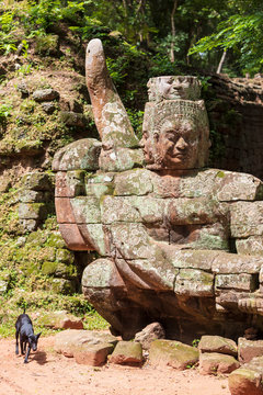 Head sculpture with a dog outside the north gate at Angkor Thom temple complex, Siem Reap, Cambodia