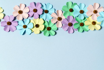 3ee4c2dcf colorful paper flowers on blue background