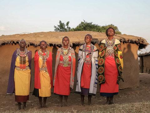 wide shot of a group of maasai women singing