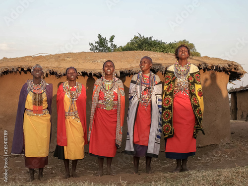 Wall mural wide shot of a group of maasai women singing