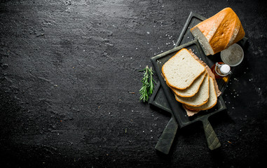 Bread with rosemary and oil on the cutting Board.
