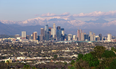 Panoramic view of the city of Los Angeles California with snowy mountain caps showing the end of the drought due to climate change.  The wide view shows Hollywood and Downtown. Wall mural