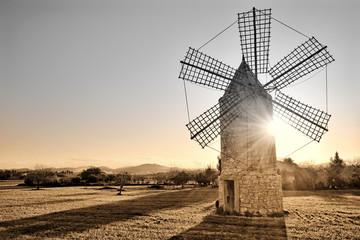 sunrise behind the mallorca windmill