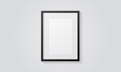 Picture frame isolated on a wall. Black and white color. Realistic modern template. A4 vertical format. Mock up for pictures or photo. Beautiful minimal clean design. Eps 10 vector illustration.