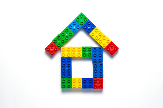 House from the children's designer on a white background. The concept of building houses, building. Flat lay, top view.