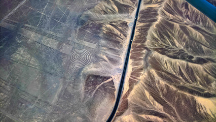 Aerial airplane panoramic view to Nazca geoglyph lines aka spiral, Ica, Peru