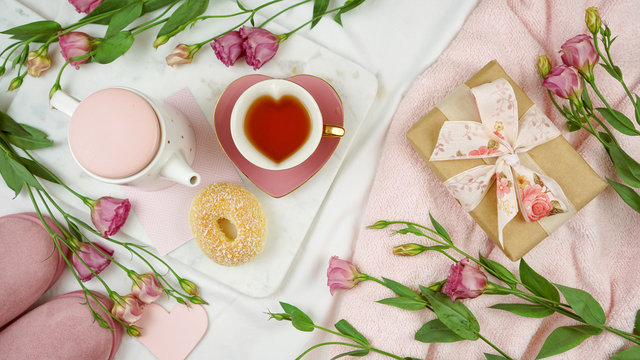 Feminine leisure and relaxation flat lay overhead, sunday morning brunch, Mother's Day, birthday or Valentine's celebration.