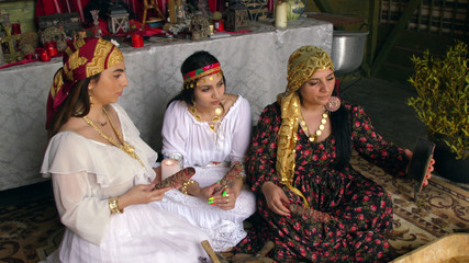A family of Romanian witches use a video call to contact a client in India paying for a love spell, in Mogosoaia