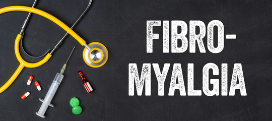 Stethoscope and pharmaceuticals on a blackboard - Fibromyalgia