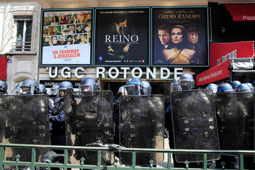 French riot police stand in front of a movie theatre in the Montparnasse district during the traditional May Day labour union march in Paris