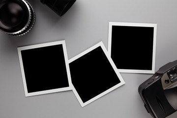 Paper photo frame with blank space, retro lens and camera