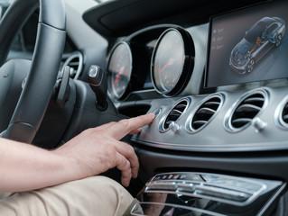Man testing additional car control at luxury car