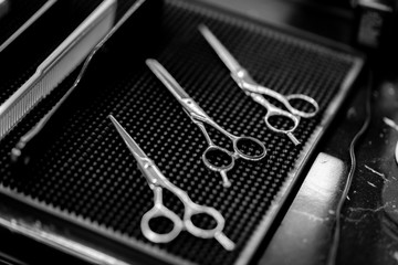 Barber scissors in the workplace. The picture was black and white.