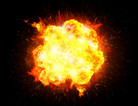 Big bright fiery explosion isolated in black background